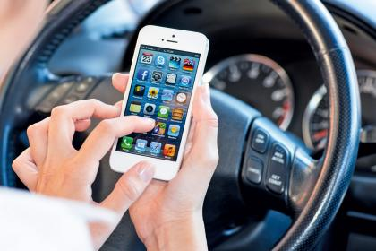 Over half of motorists use mobile phones behind the wheel, research shows.